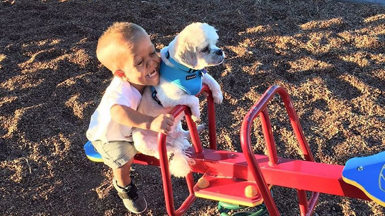 Boy and Dog With Dwarfism 3