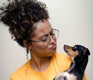 women looking at dog