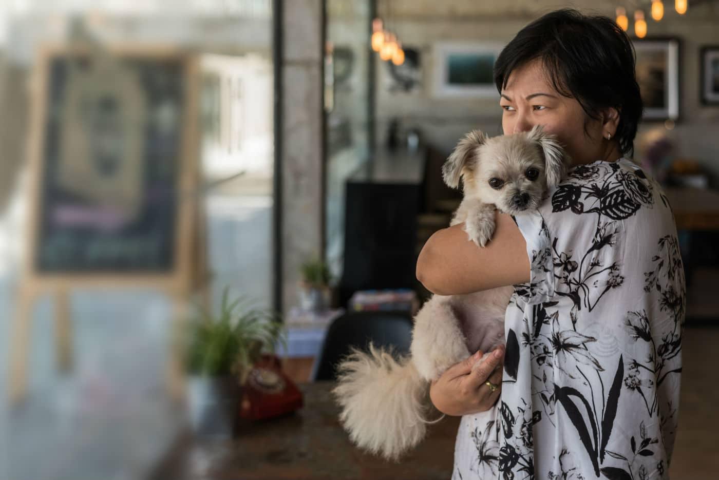 woman holding dog coronavirus