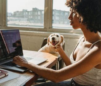 woman and dog at computer